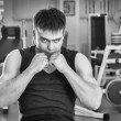 Sporty man in gym — Stock Photo #41103711