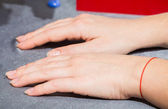 Beautiful female hands with colorless varnish on the nails — Stock Photo