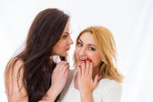 Excited women sharing secret — Stock Photo