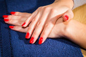Shot of beautiful female hand with red manicure — Stock Photo