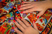Female hands with red manicure — Stock fotografie
