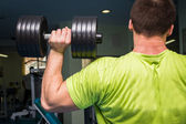 Man doing exercises with dumbbell — Stock Photo