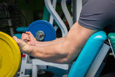 Man in a gym with dumbbells — Foto de Stock
