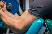Man in a gym with dumbbells — Stok fotoğraf