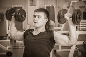 Man doing workout with dumbbell — Stockfoto