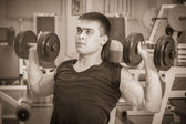 Man doing workout with dumbbell — Stok fotoğraf