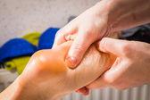 Massage of female leg — Stock Photo