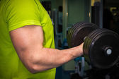 Man training with dumbbells — Stock Photo