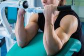 Bodybuilder doing exercises — Stock Photo