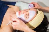 Facial mask treatment — Stock Photo