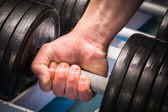 Hand holding dumbbell — Стоковое фото