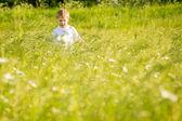 Boy walking in a field — Stock Photo