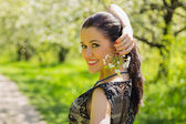 Woman on spring background — 图库照片