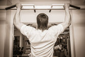 Man pulled on the bar — Stock Photo