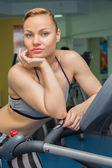 Fitness model runs on a treadmill — Stock Photo