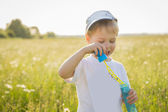 Boy playing in the field — Stock Photo