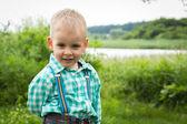 Little boy on nature — Стоковое фото