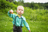Boy inflating soap bubbles — Zdjęcie stockowe