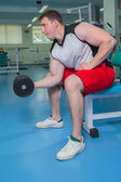 Man training with  dumbbell — Stock Photo