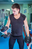 Man training  with dumbbells — Stock Photo