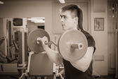 Man training with barbell — Stock Photo