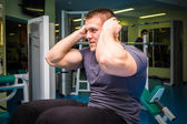 Man working out in gym — Stock Photo