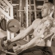 Man in tattoo in the gym — Stock Photo #48641447