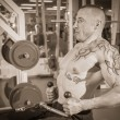Man in tattoo in the gym — Stock Photo #48641473