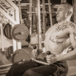 Man in tattoo in the gym — Stock Photo