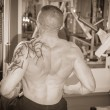 Man in tattoo in the gym — Stock Photo #48641537