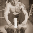 Man in tattoo in the gym — Stock Photo #48641565