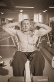 Man in tattoo in the gym — Stockfoto