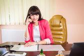 Businesswoman with magazine — Stock Photo
