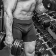 Strong man training in gym — Stock Photo #48818735