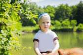 Boy riding pony — Stock Photo