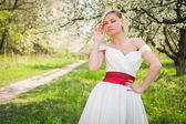 Blonde in the spring garden — Stock Photo