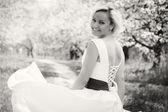 Blonde in white dress in the spring garden — Photo