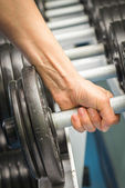 Womans hand holding dumbbell — Foto Stock