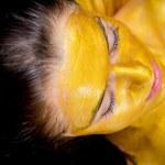 Girl makes a a golden mask — Stock Photo #50352013