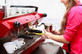 Woman making cup of cappuccino — Stock Photo