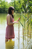 Woman in lake — Stock Photo