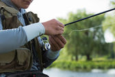 Fisherman on the river bank. — Stock Photo