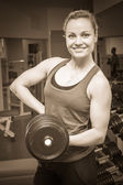 Woman holding dumbbell — Stock Photo