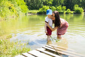 Mother with son in lake — Stock Photo