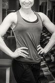 Strong woman posing in gym — Stock Photo