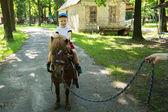 Boy riding pony — Zdjęcie stockowe