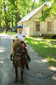 Boy riding pony — Foto de Stock