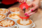 Cups of cappuccino coffee on table — Stock Photo