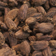Постер, плакат: Black cardamom pods on the market