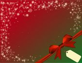 Christmas red background with red bow in green corner — Stock Photo